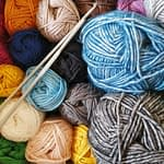 balls of yarn. Crocheting and knitting are great for earning money from your hobby.