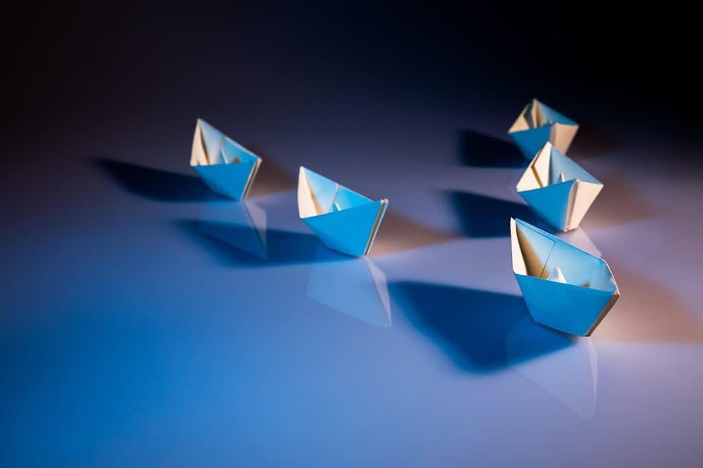 Origami paper boats. Origami is a one of the creative productive activities for university students.